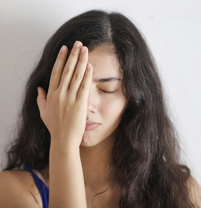 girl hiding face with hand